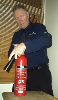 Servicing a fire extinguisher